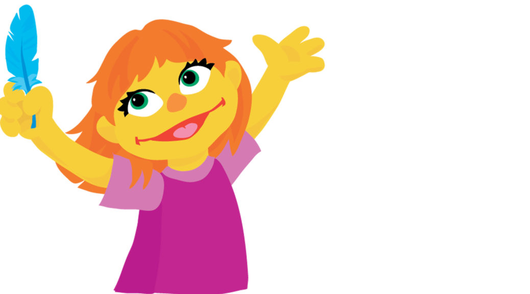 This is an image of the new autistic Sesame Street character, Julia. She has orange hair, yellow felt skin, and is wearing a purple t-shirt.