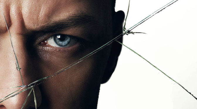 "This is an image of James McAvoy in the movie ""Split."" He is looking directly into the camera. It looks as if he is looking out from behind cracked glass."