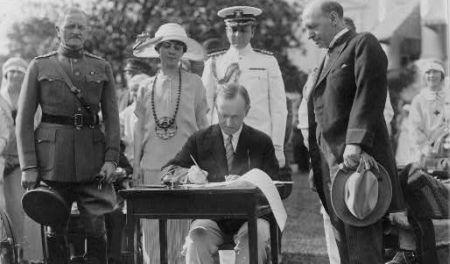 President Calvin Coolidge signing the 1924 Johnson-Reed Act.