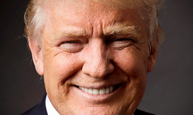 This is an image of Donald Trump. He is smiling and looks super creepy.