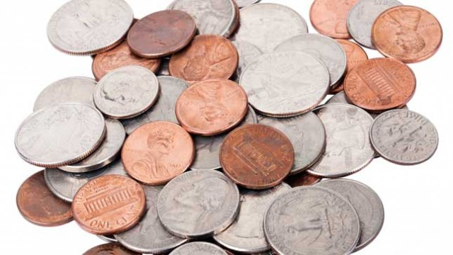 This is a pile of loose American change. There are pennies, dimes, quarters, and nickels in a scattered pile.