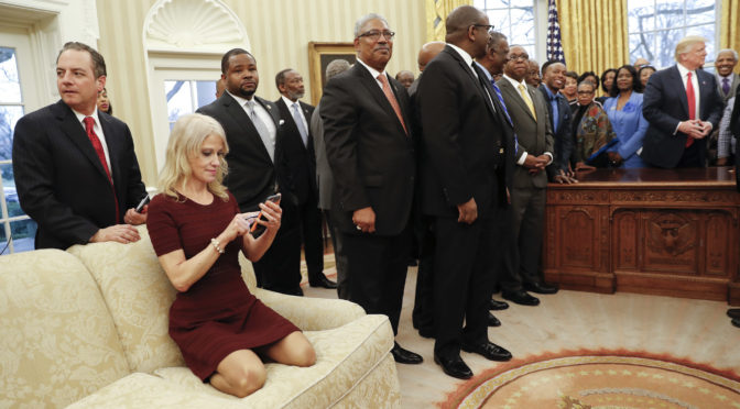 This is an image of Kellyanne Conway sitting oddly on a couch in the Oval office.