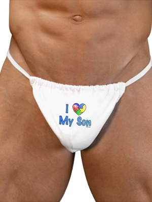 "This is an image of a white man wearing a white thong. The thong reads ""I heart my son with autism."""