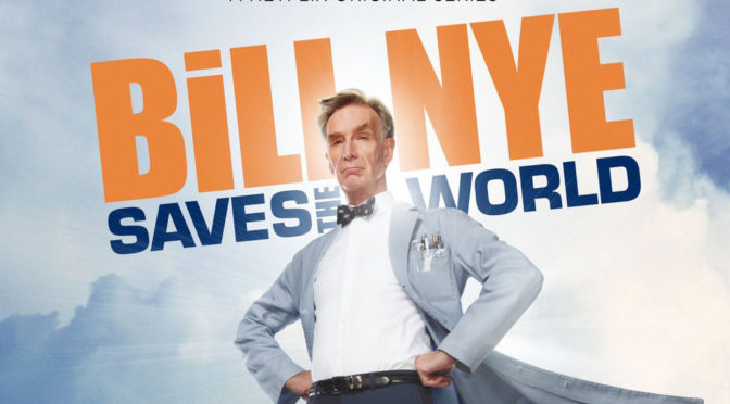 "This is an image of Bill Nye wearing a lab coat. It is billowing behind him like a super hero cape. Above him, the text is superimposed: ""Bill Nye Saves the World."""