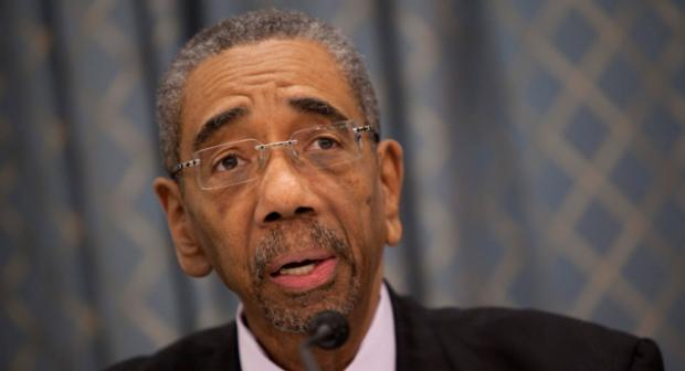 This is an image of Congressman Bobby Rush. He is an older black man with short gray hair and glasses. His eyebrows are raised.