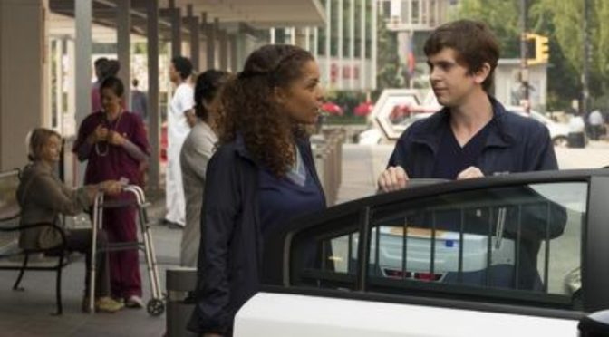 This is an image of Claire and Sean from The Good Doctor having a conversation. There is a cooler containing a transplant liver between them.
