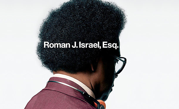 "This image shows the back of Denzel Washingnton's head. He is wearing an afro, thick glasses, and a tweet suit. He has some very old-fashioned headphones around his neck. There is white text superimposed that reads ""Roman J Israel, Esq.)"