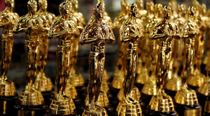 This is an image of a dozen Oscar statuettes.